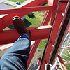 My foot on the tower, you can see the haul rope and hard line we are installing next to my carabineer