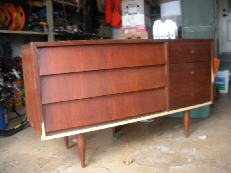 Late 1960's Harmony House, Sears dresser with mirror found at a barn style thrift store.  Missing verneer on bottom.  This is on hold as we determine if we can find some replacement verneer.  The top had a few deep scratches and two black rings where either a glass was set or a can of dark stain.
