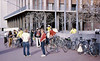 People: Gunter Hamersbach(legs crossed), Ken Leitch with helmet (hairnet), yellow jersey, Patty Rose(dark green)<br /> Subject: assemble for bike ride<br /> Place: Bancroft / Telegraph, Sproul Plaza<br /> Activity: GPP ride to Redw Reg Park<br /> Comments: <br /> 4*Sat, Mar 4, 1972