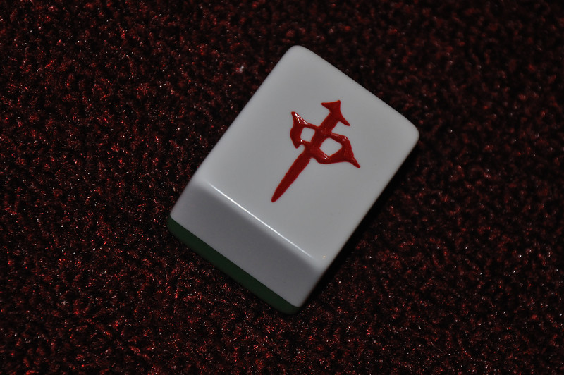 A red dragon tile sits askew.