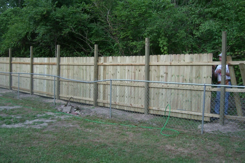 """Putting in a 6' privacy fence to replace chain link.  The city came through and thinned out the shrubs that separate us from the Monon Trail.  We suddenly had lots of """"looky-loos"""" checking us out as if we were critters at the zoo.  This fence out to help out!"""