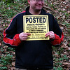 Harpers Ferry Hike: Steve poses with one of the 4-5 signs on the trees and ground about 5 feet from our camp site. Poster by H. Thompson ... H for Hunter?