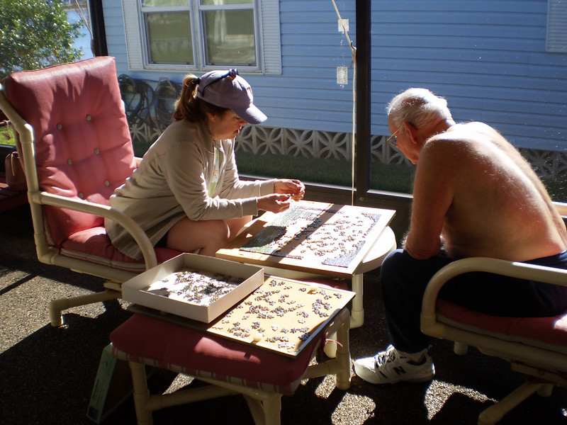 Marilyn and Harvey working on a jigsaw puzzle