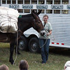 Halley Legge seems to be having more fun than the mule....I think.<br /> <br /> The mules all appeared very even-tempered and cooperative.  <br /> <br /> The only excitement was at the end of the presentation, when audience applause seemed to startle them a bit.