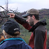 Unable to lure a Black-backed Woodpecker to the vicinity of our group, Chris Rota (right) led Moon Walkers to a vacated woodpecker nest.