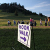 "Moon Walkers cross the BLM road en route to learning more about ""Forest Wildflowers."""