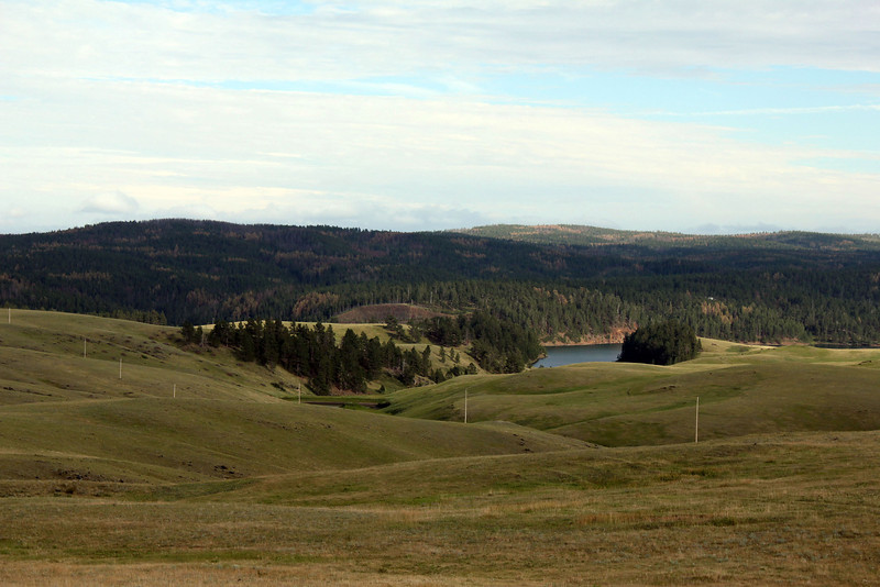 A portion of Deerfield Reservoir as seen from a knoll on Reynolds Prairie.<br /> <br /> As we arrived for this July Moon Walk, we could see just a glimpse of Deerfield Reservoir.  The Miller Cabin is not visible in this photo.