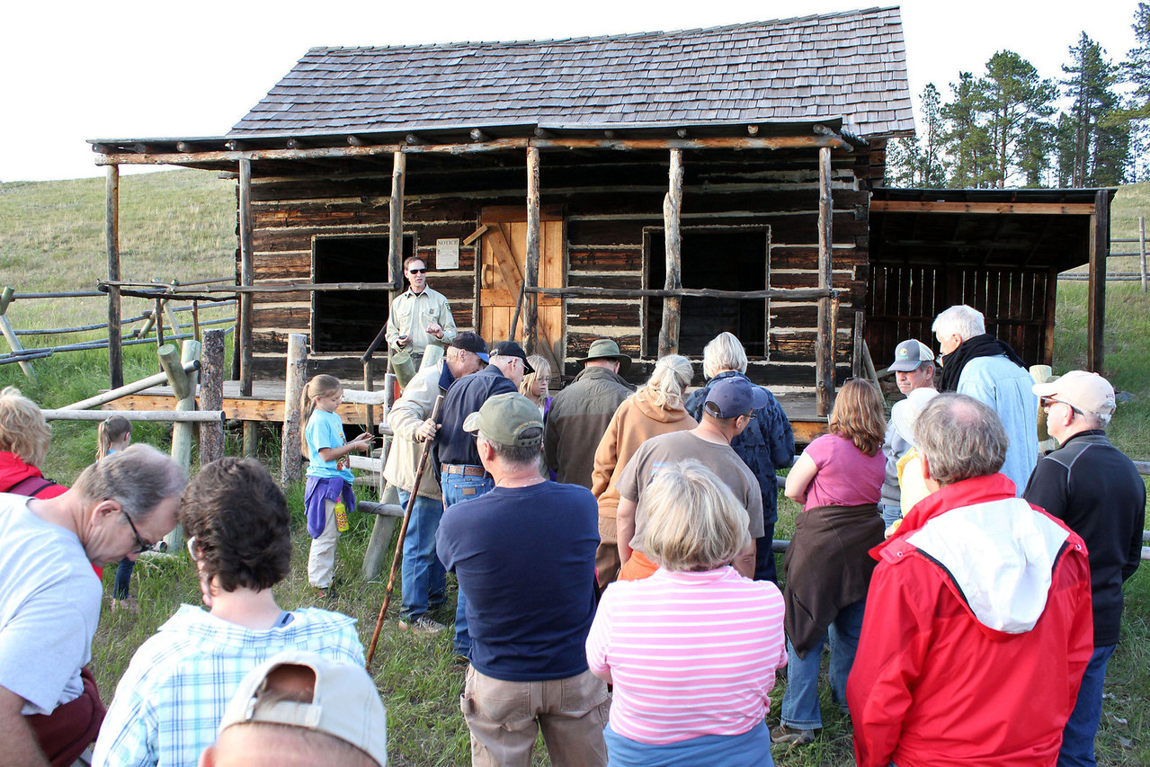 Salisbury banters with part of the group as others are arriving.<br /> <br /> Forest Service personnel and volunteers restored much of the cabin in 2008.