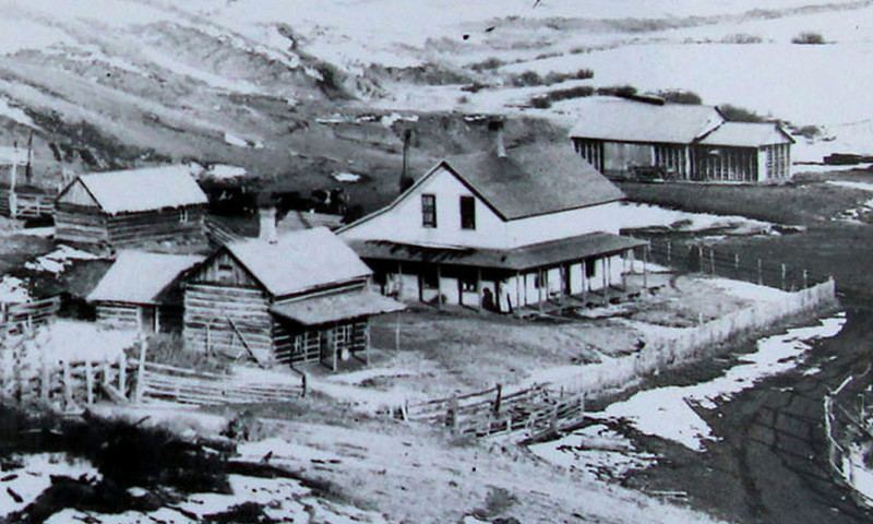 An undated photograph of the cabin (left-center) situated among several other more formidable buildings that would eventually have to be removed from the area to make way for Deerfield Reservoir.