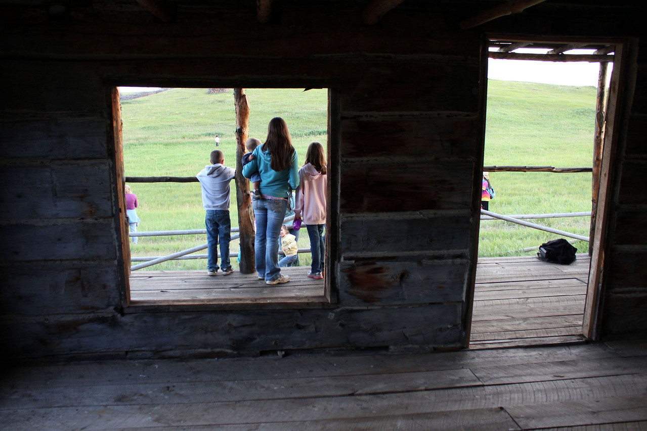 Family stands on the front door looking south toward Deerfield Reservoir, which is over the next hill.