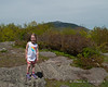 Liliana on the middle summit with Mt. Monadnock behind her
