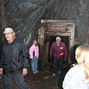 <i>Moon Walk</i> hikers  emerging from a tunnel.  According to Michael Salisbury, there is no definitive count of how many workers were involved in building the flume.  We <b>do</b> know that there were many Civil War veterans among them.    Portable blacksmith shops were a part of the construction effort.