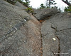 After the trail starts to come out of the trees, it follows mostly open smooth sections of rock