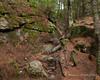 The trail follows a narrow path through some rocks