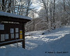 Over the snowbank and past the kiosk is the start of the trail