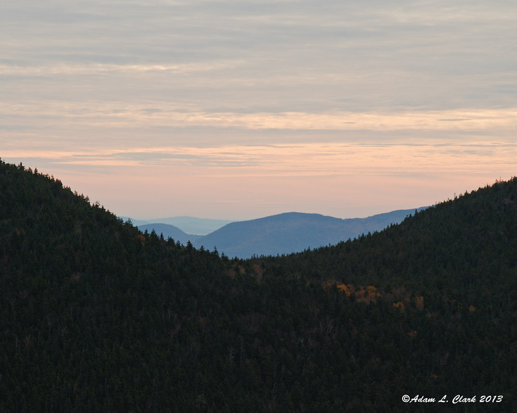 When I looked east between Sandwich Dome and Flat Mtn, there appeared to still be some color like at sunrise