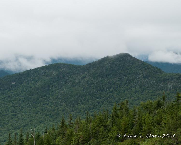 A near by peak just below the clouds
