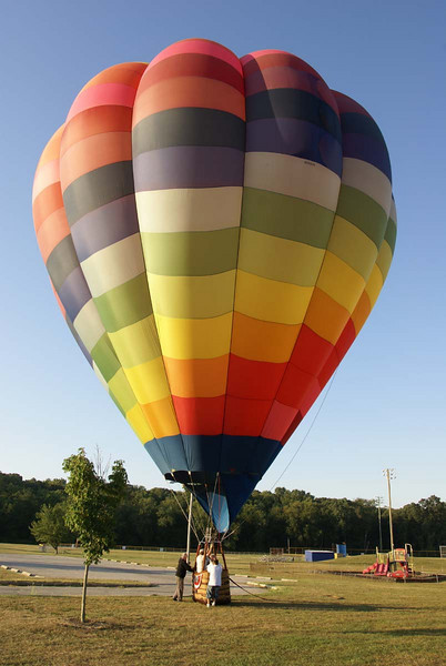 Staff Photo by TERRY HALL<br /> Upper Deerfield Aug 22 2008<br /> <br /> Early Friday morning the hot air balloon Captained by Bill Matkowshy of Centerton. landed in the Upper Deerfield Sports field. Along with Bill was his wife Glenna and fellow balloonist, John Blair of Bridgeton