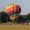 Staff Photo by TERRY HALL<br /> Upper Deerfield Aug 22,228<br /> <br /> Early Friday morning the hot air balloon Captained by Bill Matkowshy of Centerton. landed in the Upper Deerfield Sports field. Along with Bill was his wife Glenna and fellow balloonist, John Blair of Bridgeton