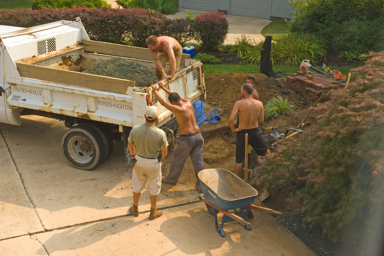 July 29, 2011: Working on the wall and begin the steps - also taking delivery of all the stone and pavers.