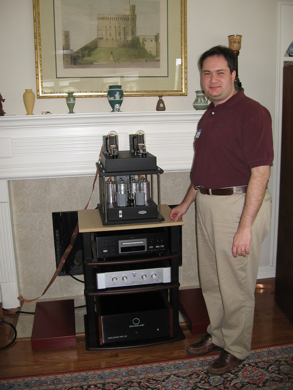 """Lee standing next to his 211 """"tower of power"""" amp."""