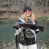 Debra Hall, Olathe, Kan., and her 2.86-pounder — the winning lunker<br /> for the women's division on Opening Day at Roaring River on March 1,<br /> 2013.