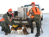 Jan. 31, 2009. Brad and Evan Blakley with four beagles, six rabbits and a squirrel after a hunt in Dodge County.