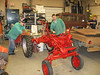 April 26, 2007. Two guys from Triton ag shop class pose with Cub mostly painted. Waiting for radiator. Meanwhile, they're working on the corn planter and cultivator.