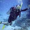 Clay scuba diving in Red Sea during our Q-family Egypt vacation. It is also an underwater imitation of a Koala bear with big glasses!