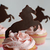 Strawberry cupcakes with strawberry buttercream.  Chocolate horse cupcake toppers