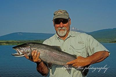 """Jim Bullen with a 30"""" rainbow."""