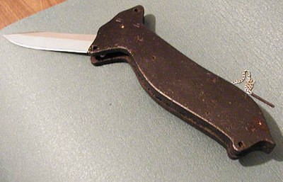 Busse Combat never came out with a folder, so Mark made one out of his SH.