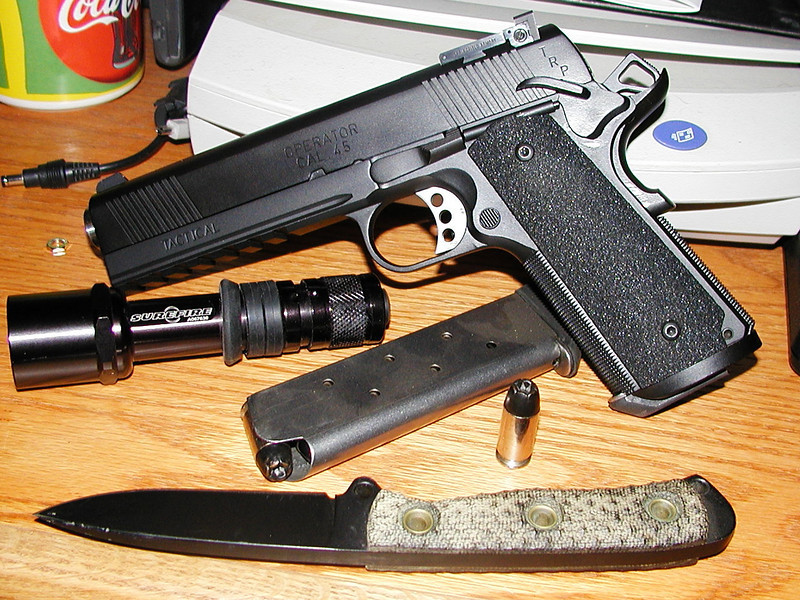 Mark's 1911 Operator and Surefire with Tina's Busse Combat Mean Street