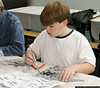 Ryan Burger (Age 11) of New Hyde Park, works on a plastic model at the Make & Take Program at the Cradle of Aviation Museum, conducted by the Long Island Scale Model Society.