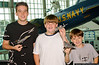 Brothers Sean (Age 15), Ryan (Age 11) and Greg Burger (Age 8) of New Hyde Park, with their model at the Make & Take Program at the Cradle of Aviation Museum, conducted by the Long Island Scale Model Society.