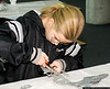 Cassandra Vnook (Age 11) of Bayville, works on a plastic model at the Make & Take Program at the Cradle of Aviation Museum, conducted by the Long Island Scale Model Society.