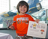 Zachery Qureshi (Age 5) of Glen Cove, with his completed plastic model at the Make & Take Program at the Cradle of Aviation Museum, conducted by the Long Island Scale Model Society.