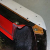 """Hard to understand this picture.  This is the <u>underside</u> of the front nose splitter.  The white material is hard nylon material used for a skid plate across the <u>entire</u> bottom of the nose splitter.  It's attached to the 1/2"""" plywood filling the recess via nutserts installed in the plywood.  The plywood is separately mounted to the splitter again using nutserts in the plywood."""