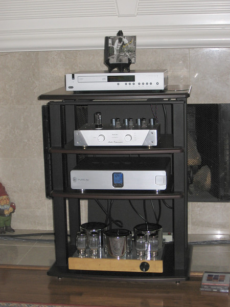 The downstairs system included an Arcam CD player, Audio Experience preamp, Belkin power conditioner, Ella KT-88 amp.