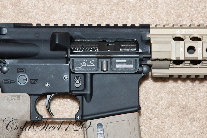 """The Dust Cover has the American Flag in """"Battle Mode"""" with INFIDEL written in Arabic."""
