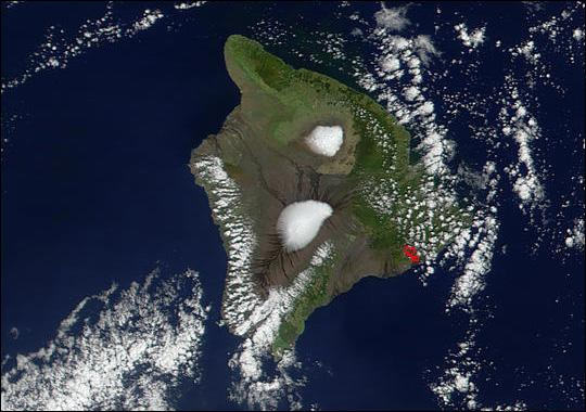 "Aerial photo of the ""Big Island"" of Hawaii, credit to Shepherd Johnson from the summitpost.org website. Note the large areas of snow on top of Mauna Kea (13,800 ft & northern mountain shown) and longer, wider Mauna Loa (13,700 ft & southern mountain shown) volcanoes! Our cabin is located on the SE section of the island, higher up slope from the red area indicated in the photo at about 4,000 ft elevation."