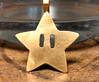Gold Super Mario Brothers invincible star pendant