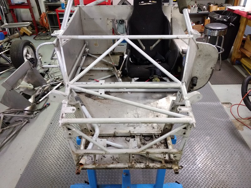 All front suspension, radiator, steering, hydraulics, and pedals now on the floor or in a box.