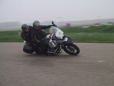 At the track in Lelystad with two-up is riding J.Schilder