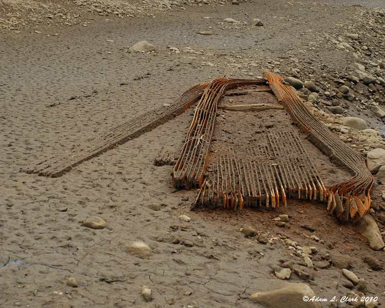 Debris that would normally be under water in the mud