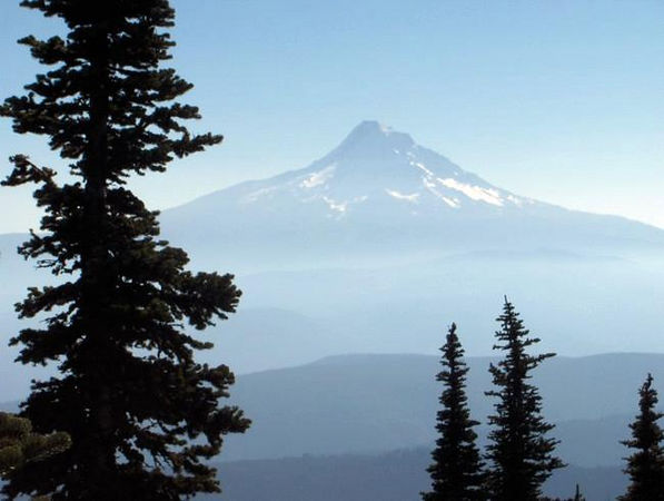 """The classic cone shaped volcanic summit of 11,239 ft Mt Hood in Oregon. Photo by """"Dragger"""", courtesy of the summitpost.org website, taken in October 2005."""
