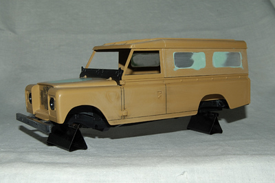 Since my Landy had no windows at the back, the windows on the original kit had to be glued in and filled up so that they could be painted over.