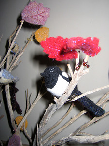 Magpie wool bird and felt leaves