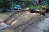 Sept. 9, 2014 - I dug the skimmer box hole today and deepened the overflow trench so that water will fall towards the sump pit which will be to the left of the little blue stool.