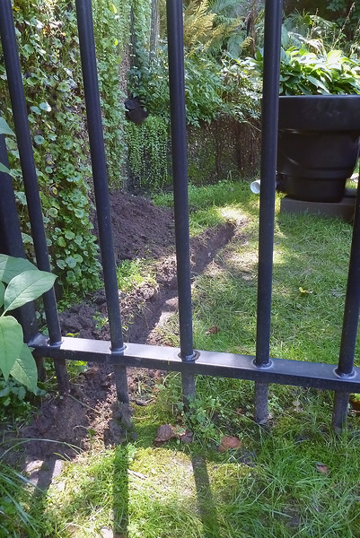 Sept. 2, 2014 - Drain line from the waterfall box.  It will end in a right-angle fitting just outside the fence where I can attach a garden hose.  There will be a shut-off ball valve located about 2 feet inside the fence..